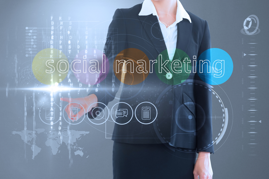 Businesswoman touching the words social media Internet marketing on interface