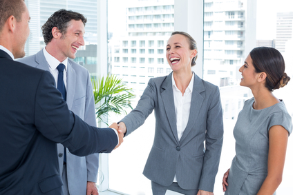 Business colleagues shaking hands with leads generated through social media