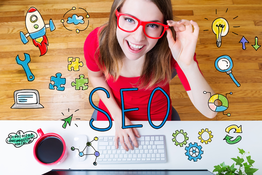 SEO concept with young woman wearing red glasses in her home office